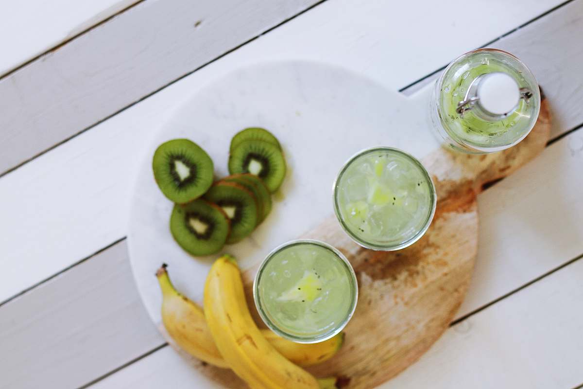 stock photos free  of drink fruit juice cups beside yellow bananas on plate beverage
