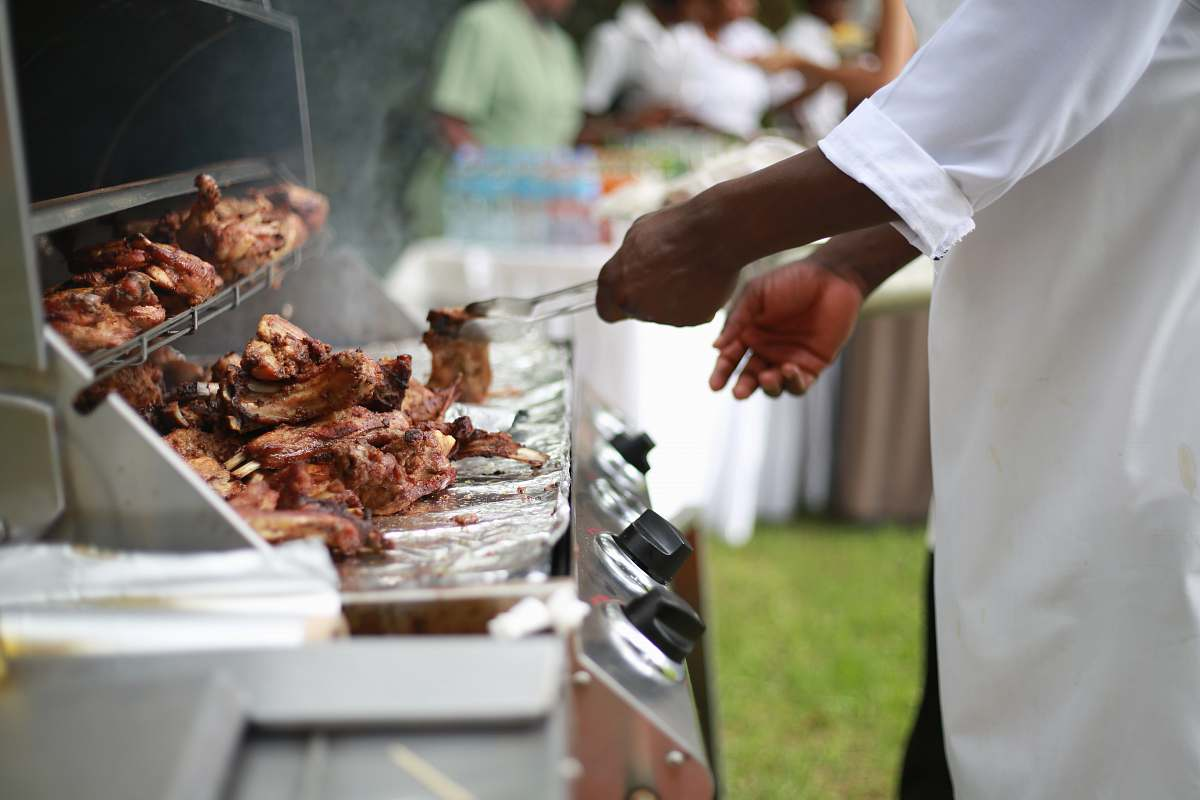 stock photos free  of uganda person in white shirt grilling meat bbq