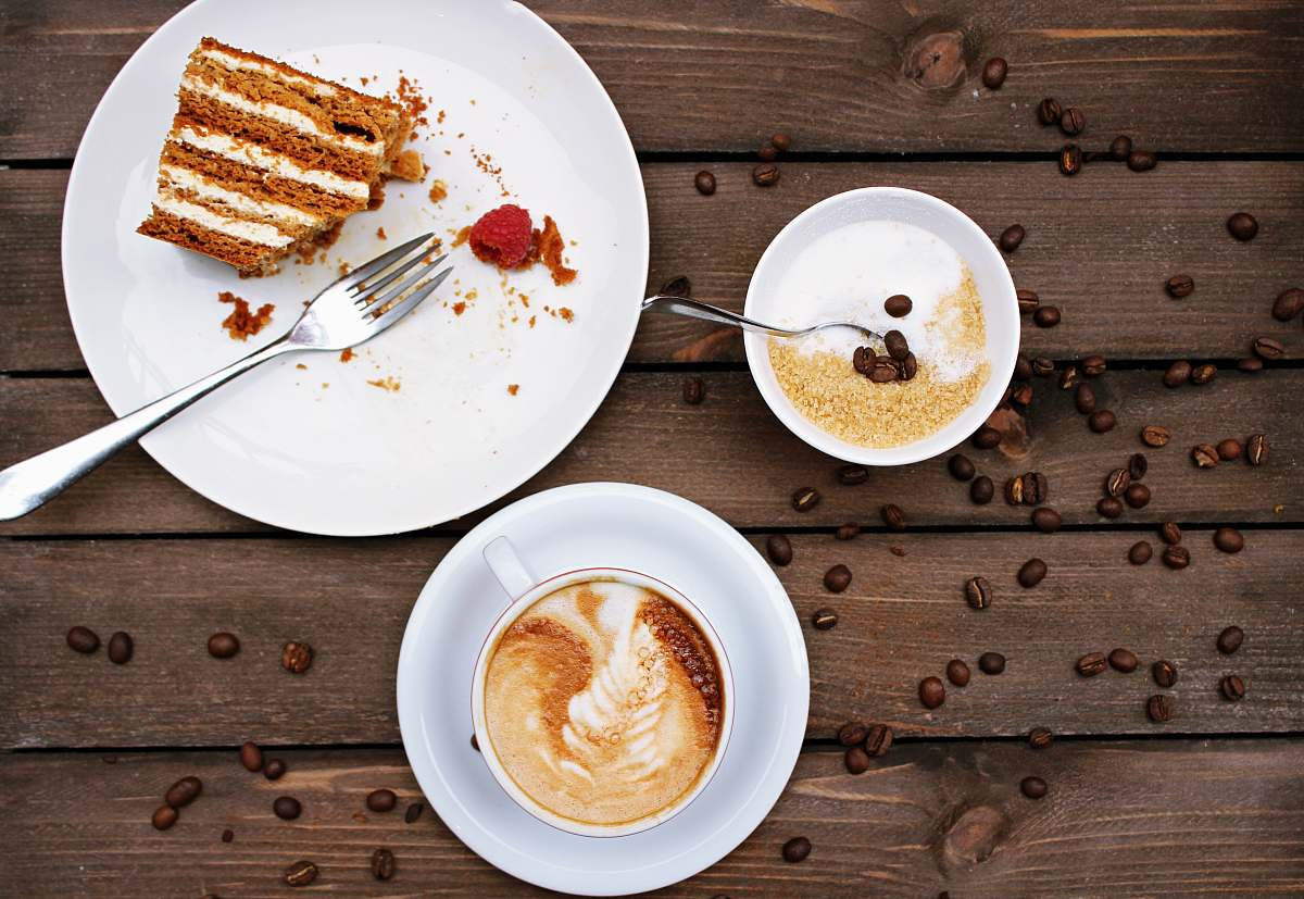 stock photos free  of coffee slice of cake on plate beside cappuccino meal