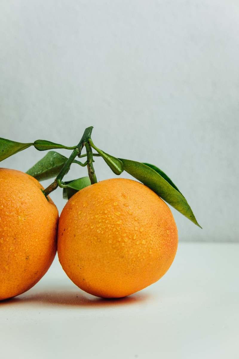 stock photos free  of fruit two orange fruits on table orange