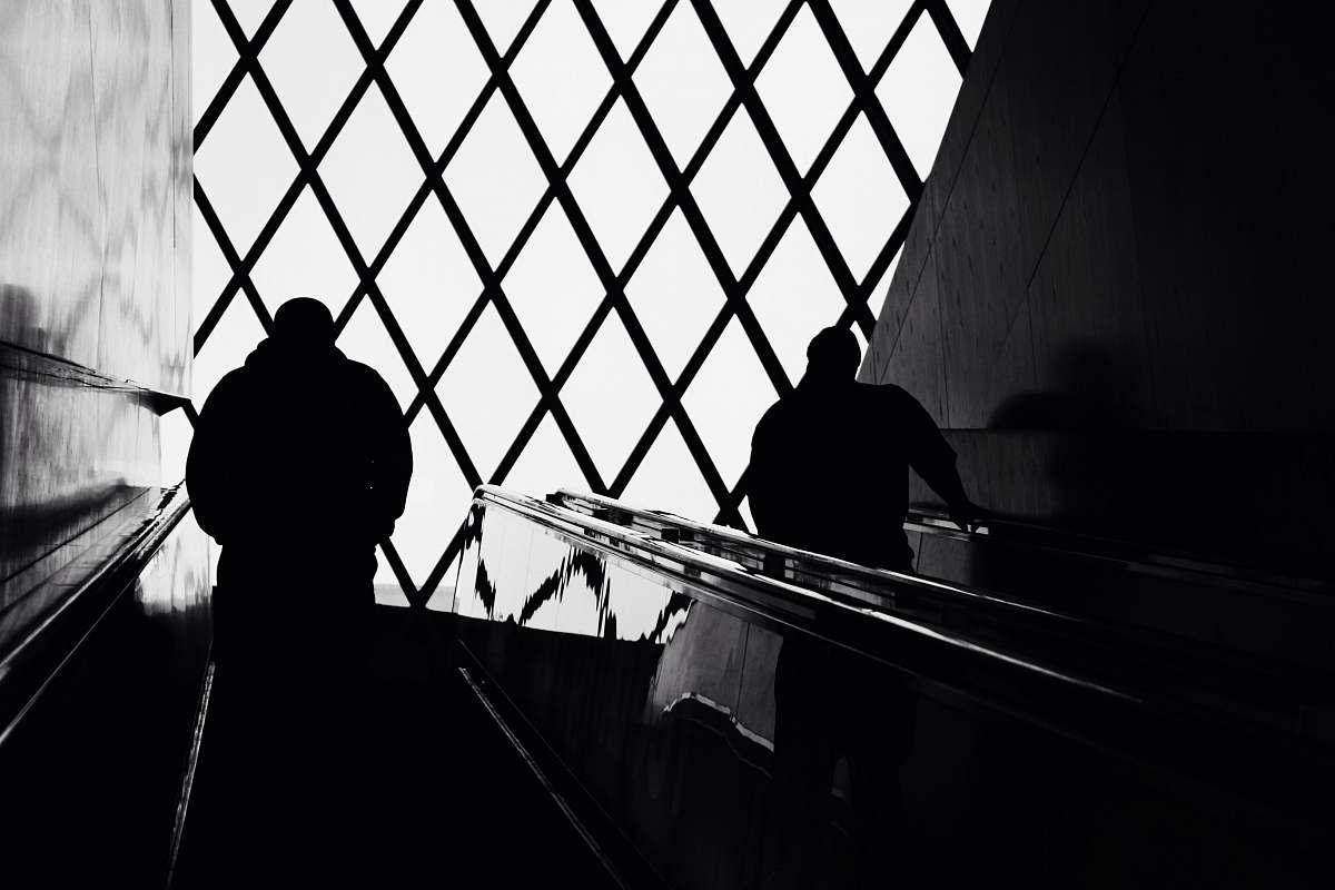 stock photos free  of banister man standing on escalator handrail