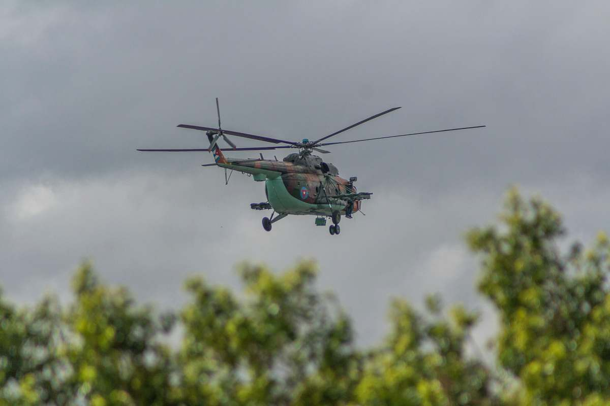 stock photos free  of vehicle green helicopter flying under cloudy sky transportation