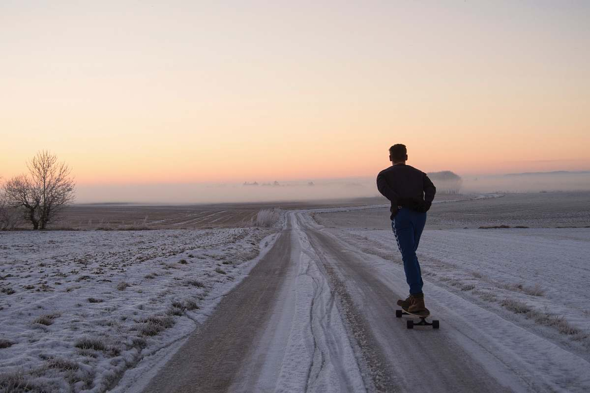 stock photos free  of people man playing skateboard on road person