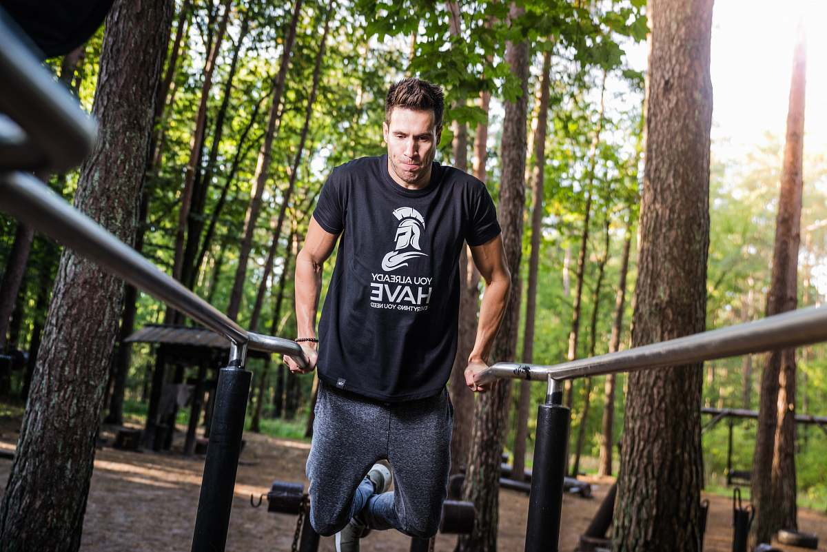 stock photos free  of person person doing dips on gray rails under shade of trees during daytime people