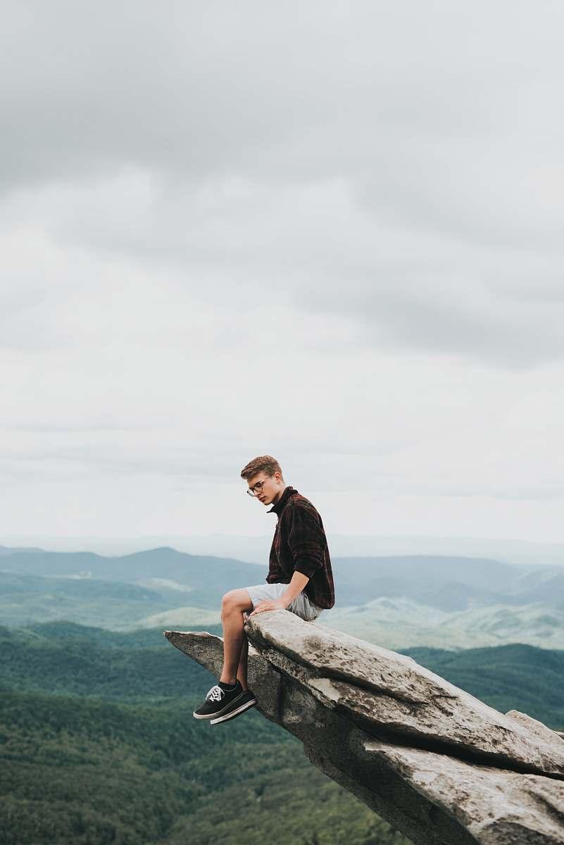 stock photos free  of human man sitting on the edge of stone person