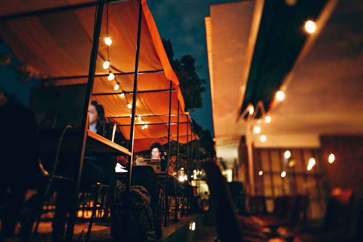 stock photos free  of human people sitting on chair outside the restaurant during nighttime person