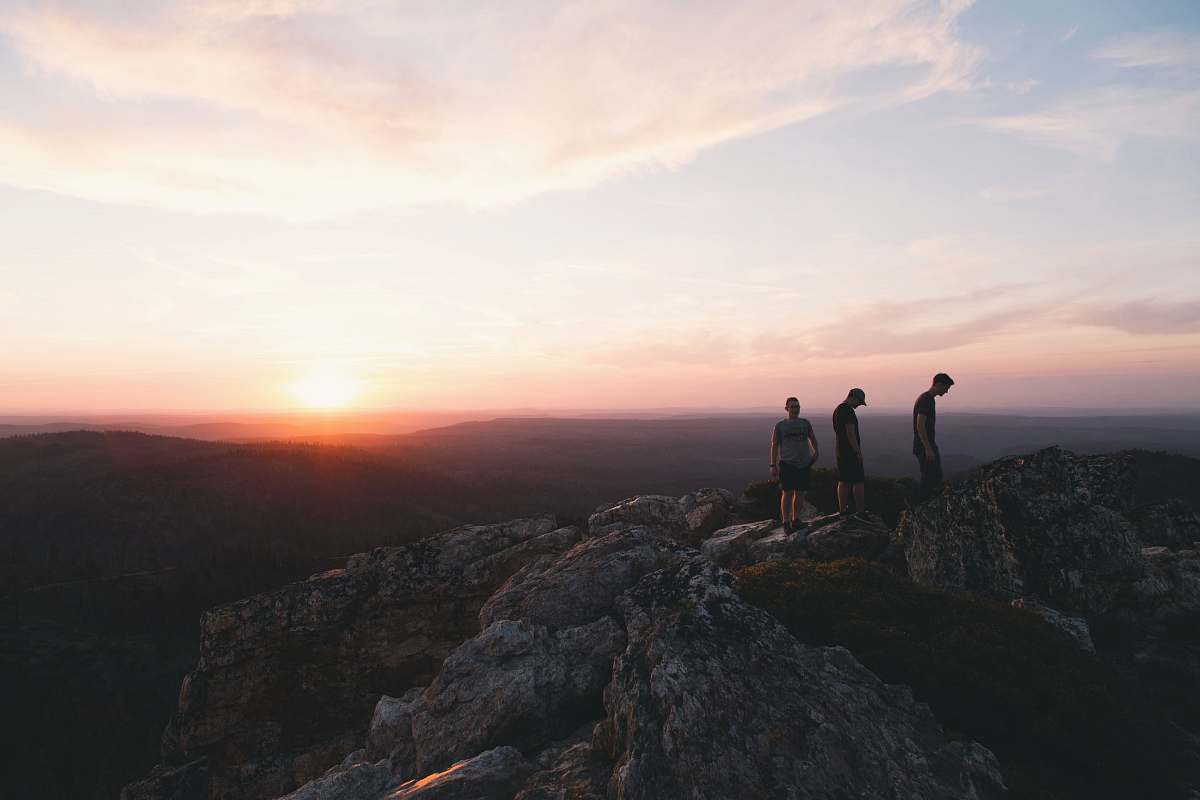 stock photos free  of sunset three person standing on mountain during daytime sunrise