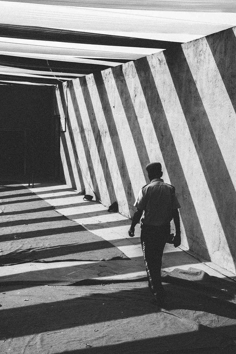 stock photos free  of people grayscale photo of man walking towards gate black-and-white