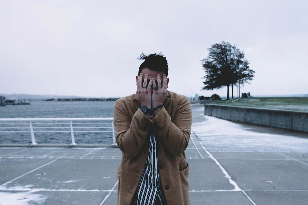 stock photos free  of human man covering face during daytime people