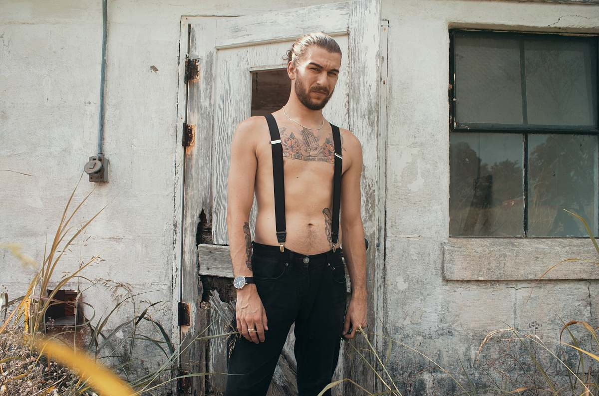 stock photos free  of human man in black suspender belt standing in front of gray house people