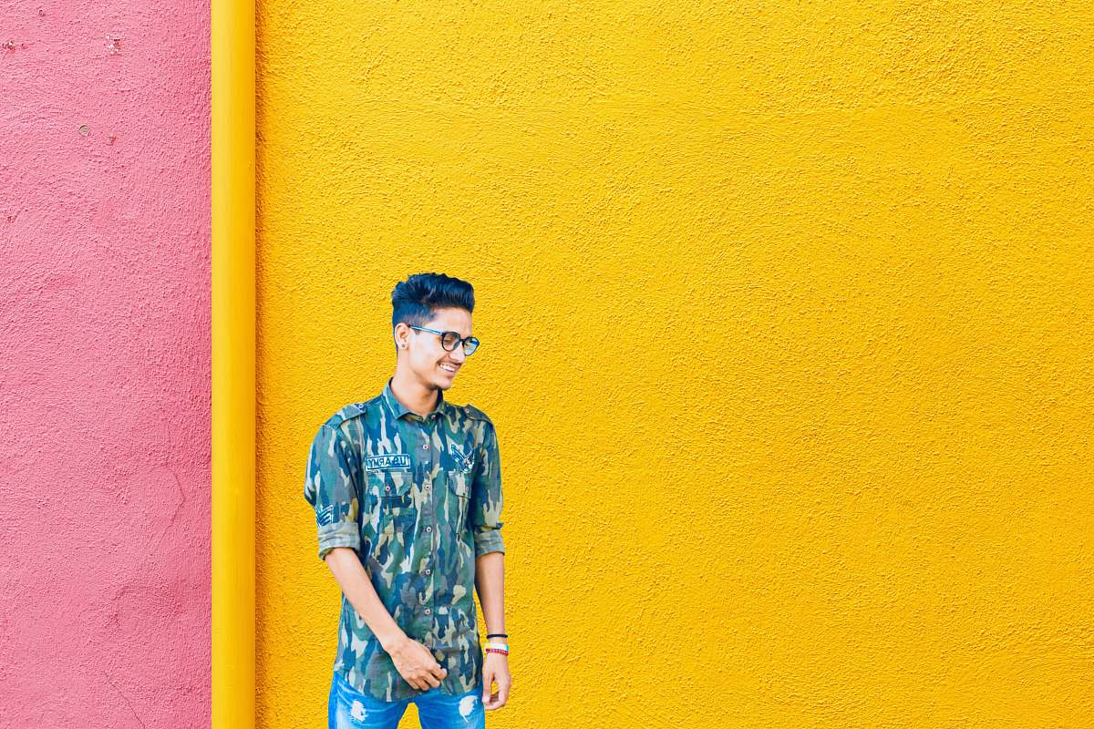stock photos free  of human smiling man standing near yellow and pink wall people