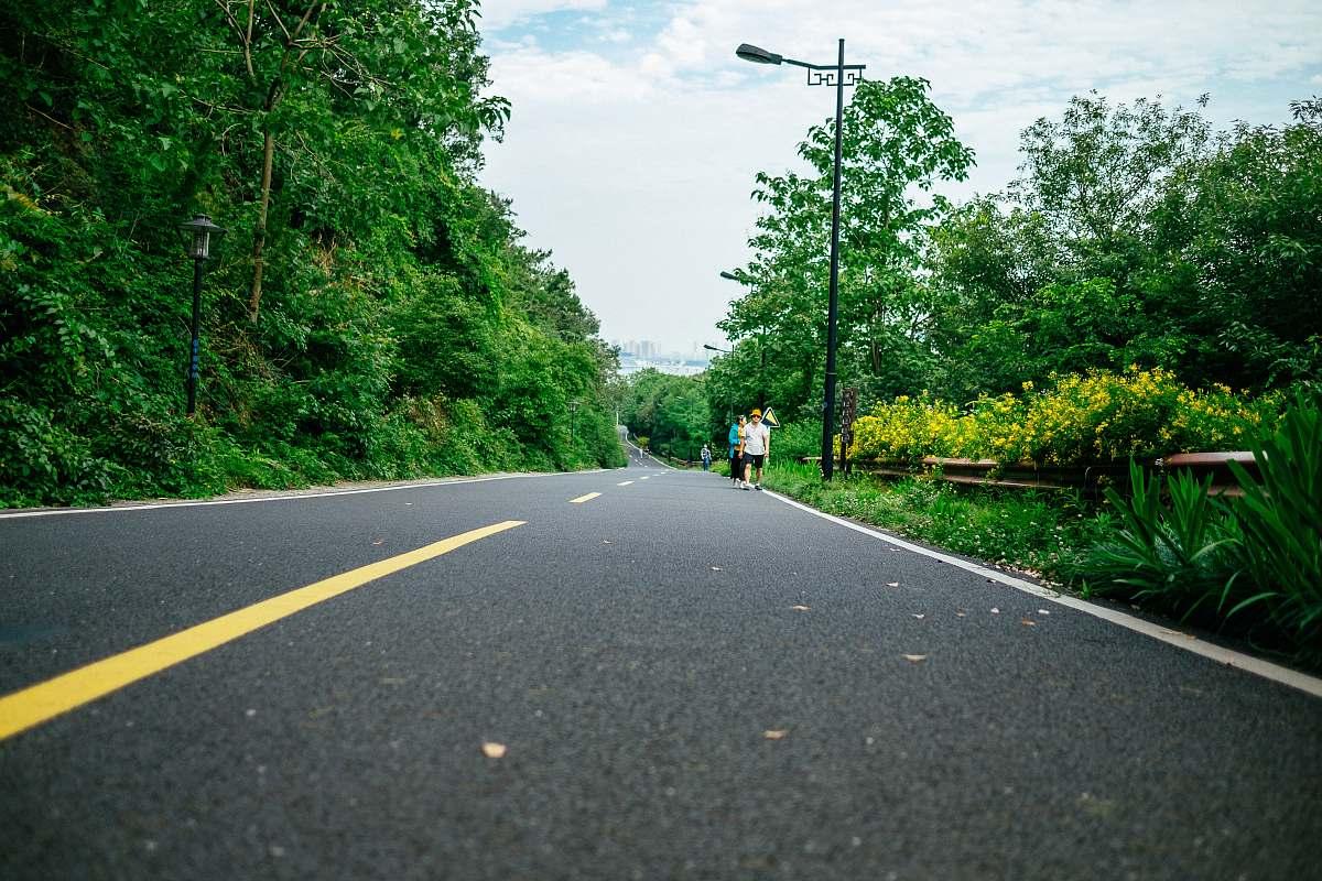 stock photos free  of tarmac person walking on street during daytime road