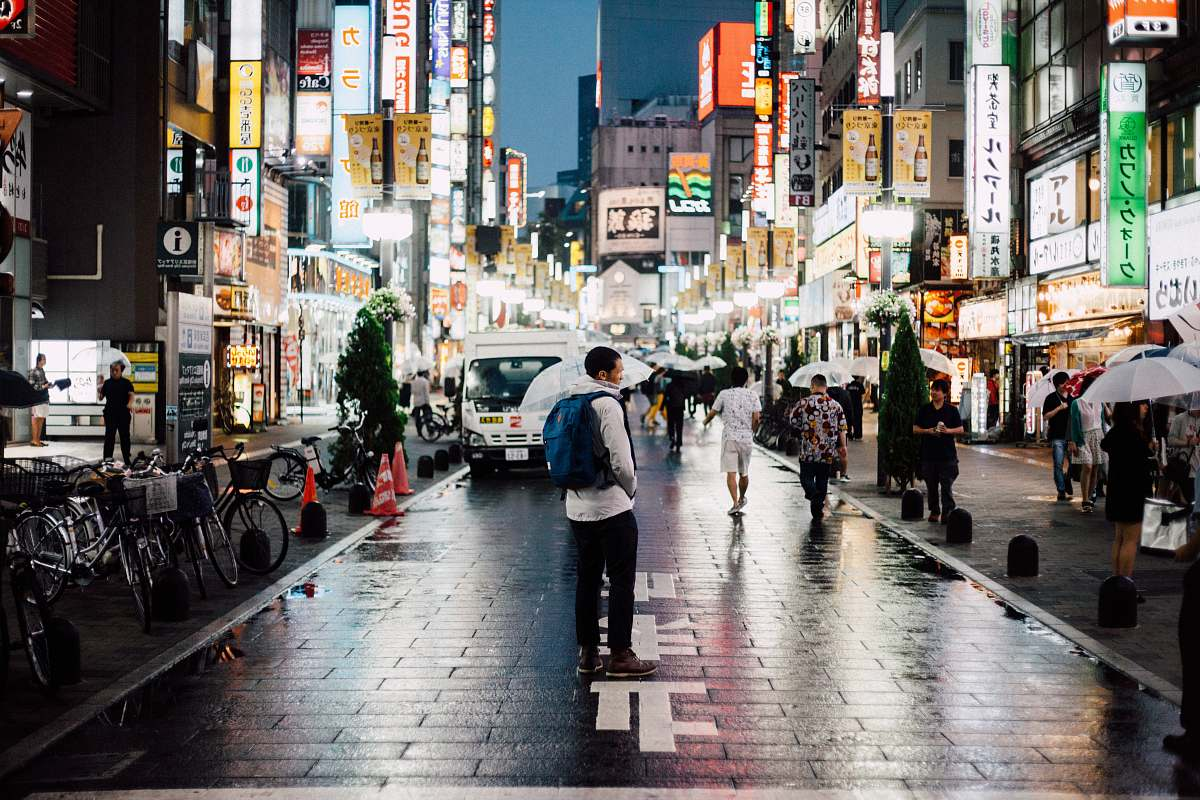 stock photos free  of bicycle man with backpack standing on street during night time transportation