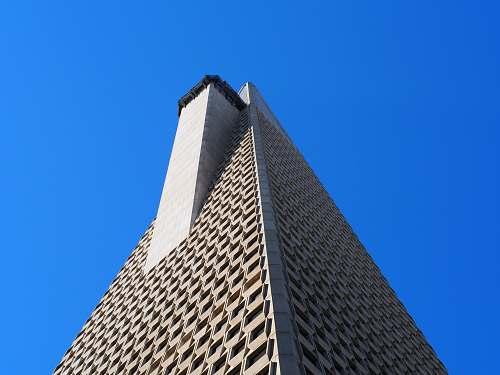 building grey concrete highrise building office building