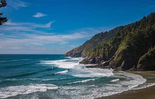 promontory seashore under blue sky coast