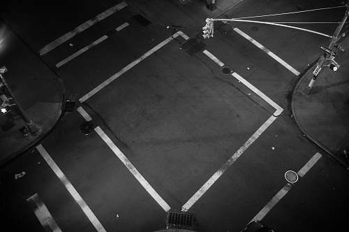 grey A look down at an empty intersection where traffic lines form a square new york