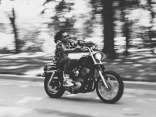 vehicle grayscale photo of man riding motorcycle transportation