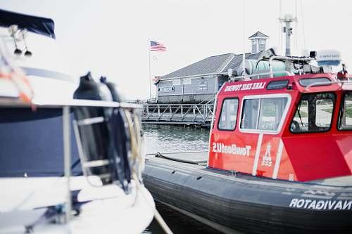 transportation red and black navigator boat vehicle