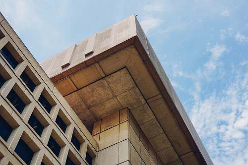architecture brown concrete building under blue sky during daytime office building