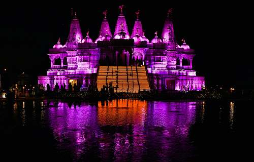 architecture building with pink and orange lights at night castle