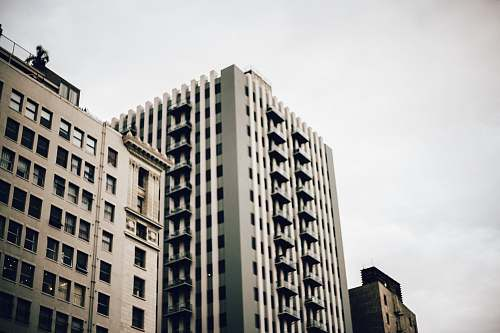 downtown high-rise building under nimbus clouds architecture