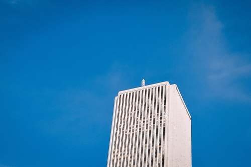architecture low angle photo of white high-rise building under blue sky skyscraper