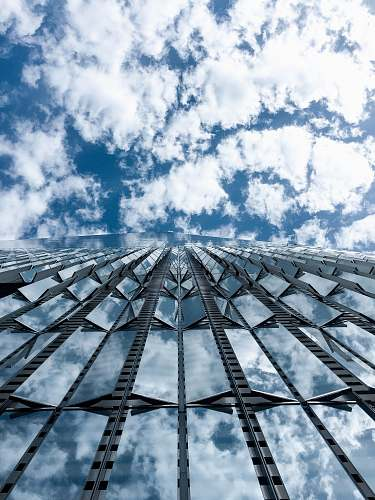 building close-up photography of high-rise building under cloudy sky during daytime new york