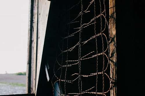 chicken brown metal barbwire nera plank fence