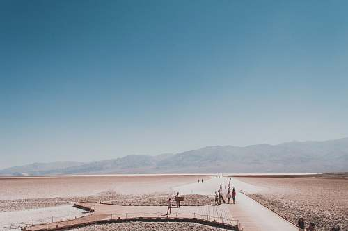 landscape people walking on path towards mountains badwater