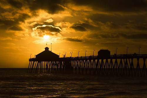 pier silhouette photo of sea dock at golden hour imperial beach