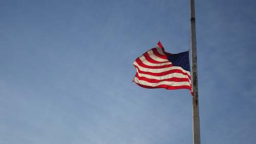emblem America flag on pole pole