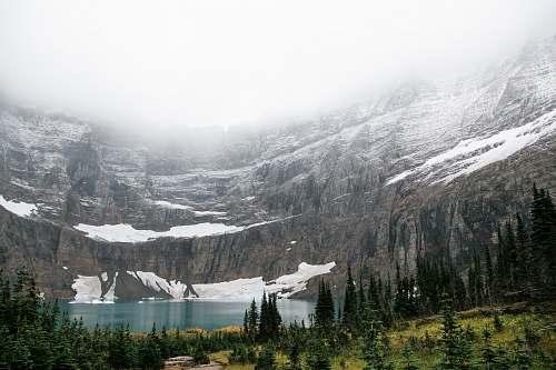mountain landscape photo of lake near mountain snow