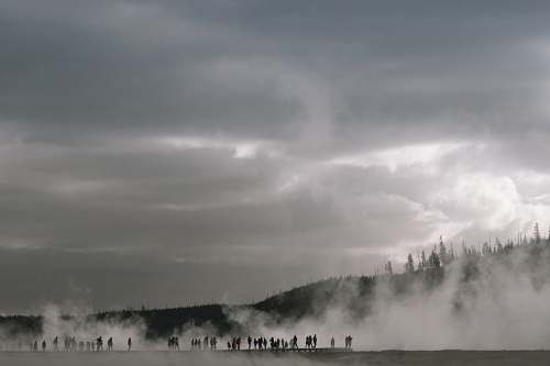 steam people near mountain with fogs yellowstone national park