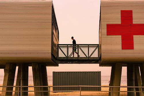 banister person standing on intermodal container railing