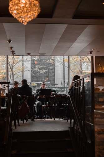 restaurant man sitting near the window cafe