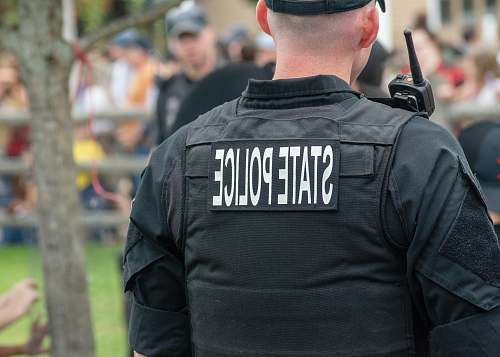 person person wearing black State Police vest people