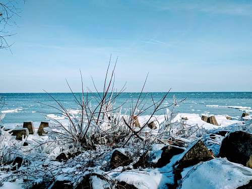 outdoors snow covered woods under blue sky coast