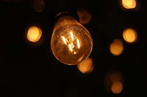 lightbulb bokeh lights photography of filament light bulb at night massachusetts