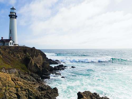 california photo of lighthouse on cliff beacon