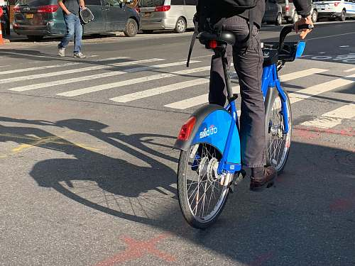 wheel man riding blue bicycle asphalt