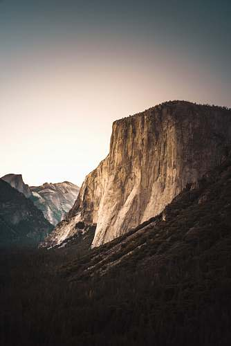 outdoors landscape of mountain near trees cliff