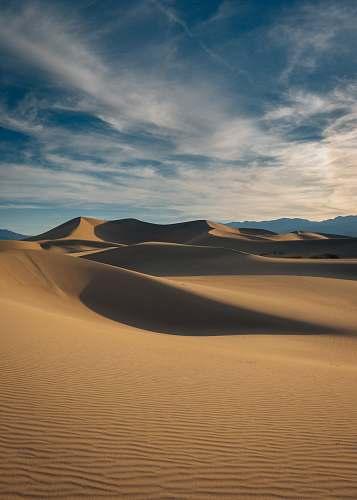outdoors brown desert under blue sky soil