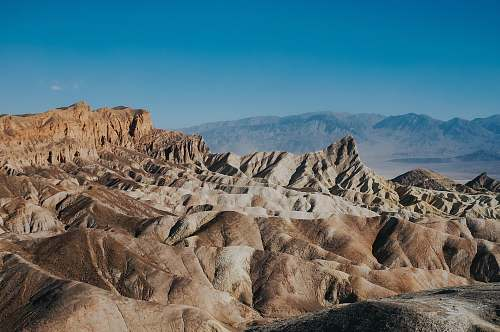 desert brown loess under clear blue sky mountain