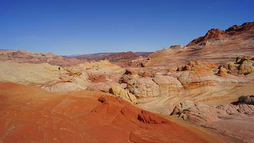 outdoors brown rock formations under blue sky mountain