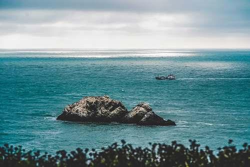 beach coastal rock at body of water coast