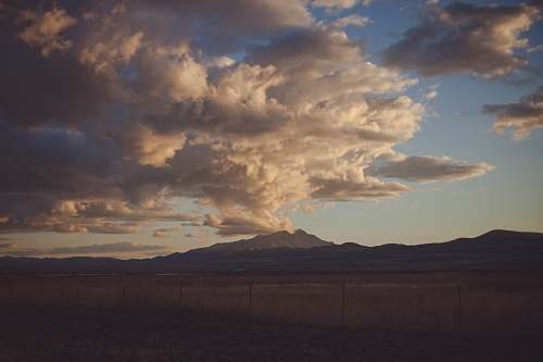 weather mountain under white and gray skies cloud