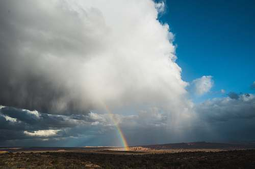 united states rainbow under cloudy skies moab