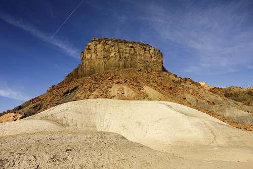 mesa brown mountain during daytime desert