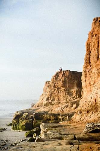 cliff man on cliff near water carlsbad