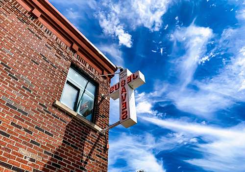 nature white Jesus Saves cross sign brick
